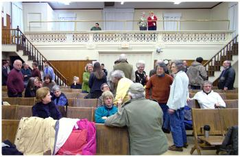 The audience in Searsport's Union Hall during a break in deliberations Wednesday night. (Photo by Ethan Andrews)